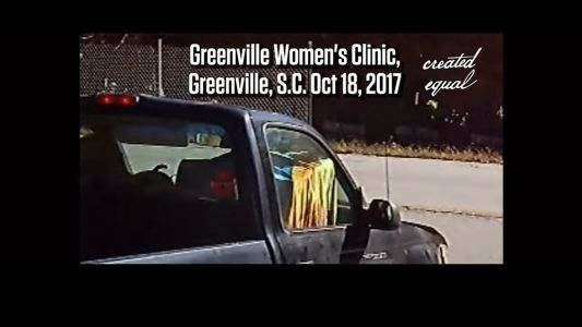 """Abortion clinic worker caught on video transporting dead babies in a passenger car to have them """"recycled"""" by a waste truck"""