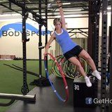 We've Never Seen Anyone Do This With a Hula Hoop and a Pull-Up Bar