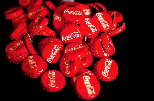 Coca-Cola rolls out a recycled bottle made with a tiny fraction of all the plastic waste the unethical corporation has dumped on the world