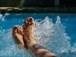 Obese women should soak in HOT TUBS to lower risks of heart woes