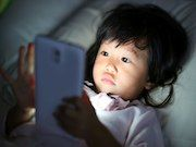 Tech At Bedtime May Mean Heavier Kids