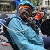 Model Mama Cax Lost Her Leg to Cancer and, Years Later, Handcycled the NYC Marathon