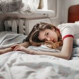 If You Sleep Worse on Your Period, a Doctor Says This Might Be Why - and How to Fix It