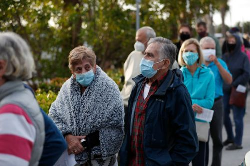 Hundreds Of Florida Seniors Camp Out Overnight To Get COVID Vaccine