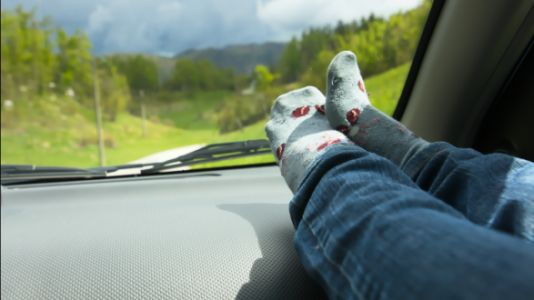 Why You Shouldn't Put Your Feet On The Dashboard While In A Moving Vehicle