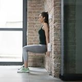 Here's How to Up Your Wall-Sit Game For Stronger Legs, According to a Former Gymnast