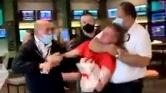 Medical police state HORRORS in Australia: Young man choked out, slammed to the ground, heaved out of a restaurant for not wearing a mask