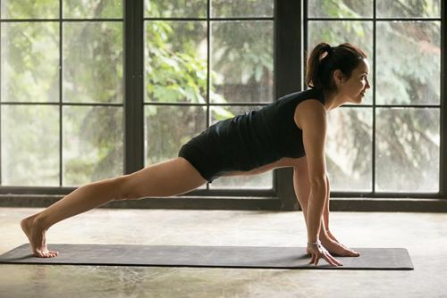 Try yoga to relieve back pain caused by cycling or spinning