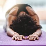 Grab a Pillow and Release Tension in Your Tight Hips With These 4 Gentle Yoga Str