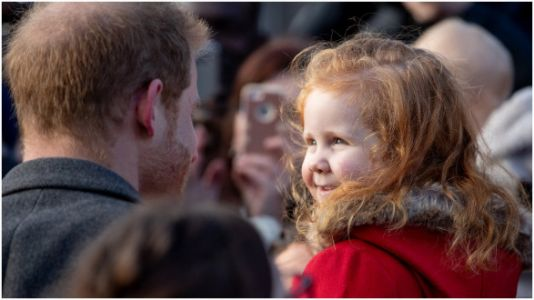 Prince Harry Hugs A Fellow Redhead Thanks To Her Attention-Grabbing Sign