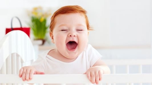 When do babies sleep through the night?